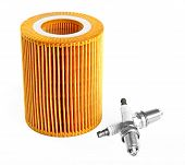 image of lube  - Oil filter and two spark plugs isolated over white background - JPG