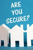 foto of disaster preparedness  - The question Are You Secure above a chain of white paper houses on a blue background - JPG