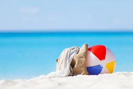 foto of balls  - colorful beach ball and beach accessories at the perfect tropical beach - JPG