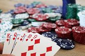 picture of flush  - Photo of winning poker hand with straight flush before chips - JPG