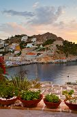 picture of hydra  - View of the port of Hydra over a terrace of a house - JPG