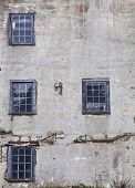 foto of dirty  - Wall of an old building with windows - JPG