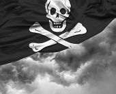 image of pirate flag  - Pirate waving flag on a bad day - JPG