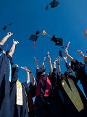 picture of throw up  - high school students graduates tossing up hats over blue sky - JPG