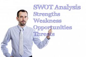 stock photo of swot analysis  - SWOT Analysis Young businessman with small beard pointing up in blue shirt - JPG