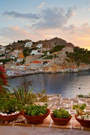 stock photo of hydra  - View of the port of Hydra over a terrace of a house - JPG