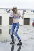 Beautiful Young Girl Jumped Into A Puddle. poster