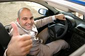 stock photo of luxury cars  - Businessman in the car details of inside a car - JPG