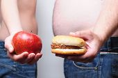 stock photo of xxl  - Unhealthy and healthy diet - JPG