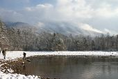 Lake And Mountians With Snow