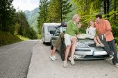Family with camping car on the road