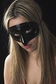 Young Woman Wearing A Black Mask