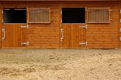 an empty horse stable. The horse out for a ride
