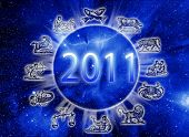 astrology concept with Universe, astrological symbols and the new year of 2011 year