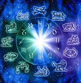 old and modern symbols of zodiac signs with mystic wheel with light over starry Universe