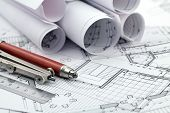 rolls of architecture blueprint & work tools - ruler, pencil, compass