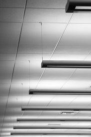 foto of light fixture  - Row of fluorescent lights in an office building - JPG