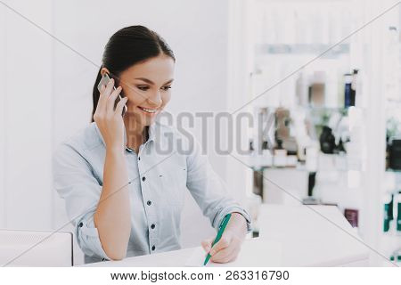 poster of Woman Receptionist. Receptionist In Workplace. Workplace In Beauty Salon. White Interior. White Rece