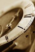 old worn clock, sepia toned