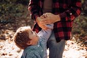 Childhood Concept. Dad And Son In The Autumn Park Play Laughing. Happy Joyful Father With A Cute Son poster