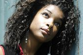 stock photo of afro hair  - girl looking  - JPG