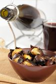 Roasted sweet chestnuts and red wine