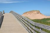 A boardwalk over the sand dunes to the beach in Cavendish National Park, Prince Edward Island, Canada.