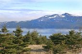 A view of the fog rolling into a bay in Gros Morne National Park (a Unesco site), Newfoundland, Cana