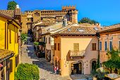 Mediaeval Town Buildings Of Gradara Italy Colorful Houses Village Streets . poster