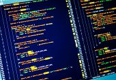 Lines Of Php Code On The Screen, Close Up. Yellow, Orange And Green Coding On Dark Blue Background poster