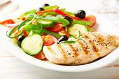 Grilled chicken breast with green and red pepper, cherry tomatoes, lettuce, black olives, cucumber,  poster