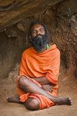 TIRUVANNAMALAI, INDIA - JANUARY 7: Sadhu (holy man) meditating in cave on Mt Arunachala on January 7, 2010 in Tiruvannamalai, Tamil Nadu, India