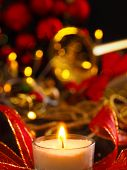 Festive Christmas Decoration With One Burning Candle And Brass Instrument In The Background poster