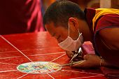 MCLEOD GANJ, INDIA - MAY 22: Buddhist monks making sand mandala on May 22, 2010 in McLeod Ganj, Indi