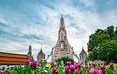 Wat Arun Ratchawararam With Beautiful Blue Sky And White Clouds. Wat Arun Buddhist Temple Is The Lan poster