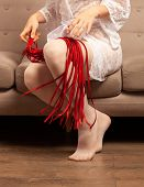 Beautiful Female Legs In White Stockings And A Red Whip poster