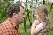 image of disobedient  - father attempting to discipline his daughter - JPG