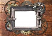 Grunge background with metallic frame with vintage machine gears and cogwheel. Mock up template. Can poster