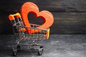 Red Heart In The Supermarket Trolley. Concept Of Buying Love. Valentines Day. Yellow Background. Lo poster