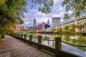 Cleveland, Ohio, USA downtown skyline on the Cuyahoga River at dusk. poster