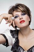 pic of diamond ring  - Beautiful woman with black makeup and big diamond ring - JPG