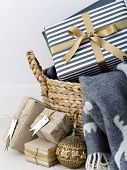 Basket With Plaid And Different Present Boxes Decorated For Christmas. poster