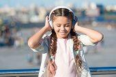 Little Girl Listening Music Enjoy Favorite Song. Girl With Headphones Urban Background. Positive Inf poster