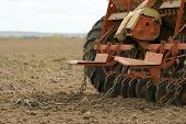 Close-up of seeding machine at field.