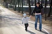 Mother and her son walking in a park