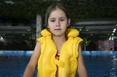 A Half Length Shot Of A Little Cute Girl In A Swim Device At The Water Park Background. A Little Gir poster