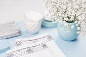 Fashion Cosmetic Products - White Soap, Towel, Flowers, Soap Dispenser, Blue Ceramic Vase, Silver Co poster