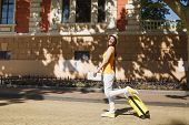 Pretty Traveler Tourist Woman In Yellow Summer Casual Clothes Hat With Suitcase City Map Walking In  poster