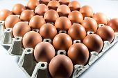 Fresh Eggs From The Farm In The Panel White Paper. Background Eggs Arranged In Panels Paper. Eggs An poster