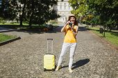 Traveler Tourist Woman In Yellow Casual Clothes Hat With Suitcase Taking Pictures On Retro Vintage P poster